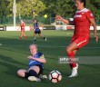 KANSAS CITY, KS - MAY 27:  FC Kansas City defender Becky Sauerbrunn (4) makes the sliding tackle against Washington Spirit forward Katie Stengel (12) in the first half of an NWSL women's soccer match between the Washington Spirit and FC Kansas City on May 27, 2017 at Children's Mercy Victory Field in Kansas City, MO.   (Photo by Scott Winters/Icon Sportswire)