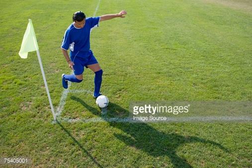 Footballer taking a corner kick : Stock Photo