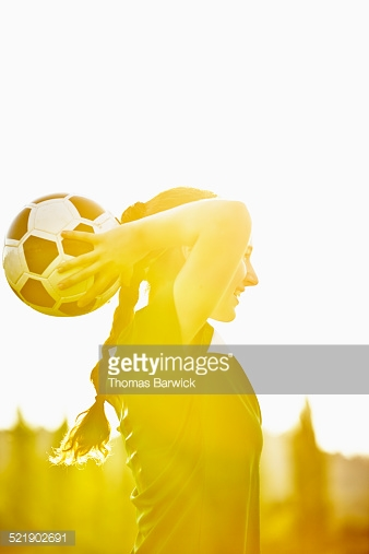 Female soccer player preparing to throw in ball : Stock Photo