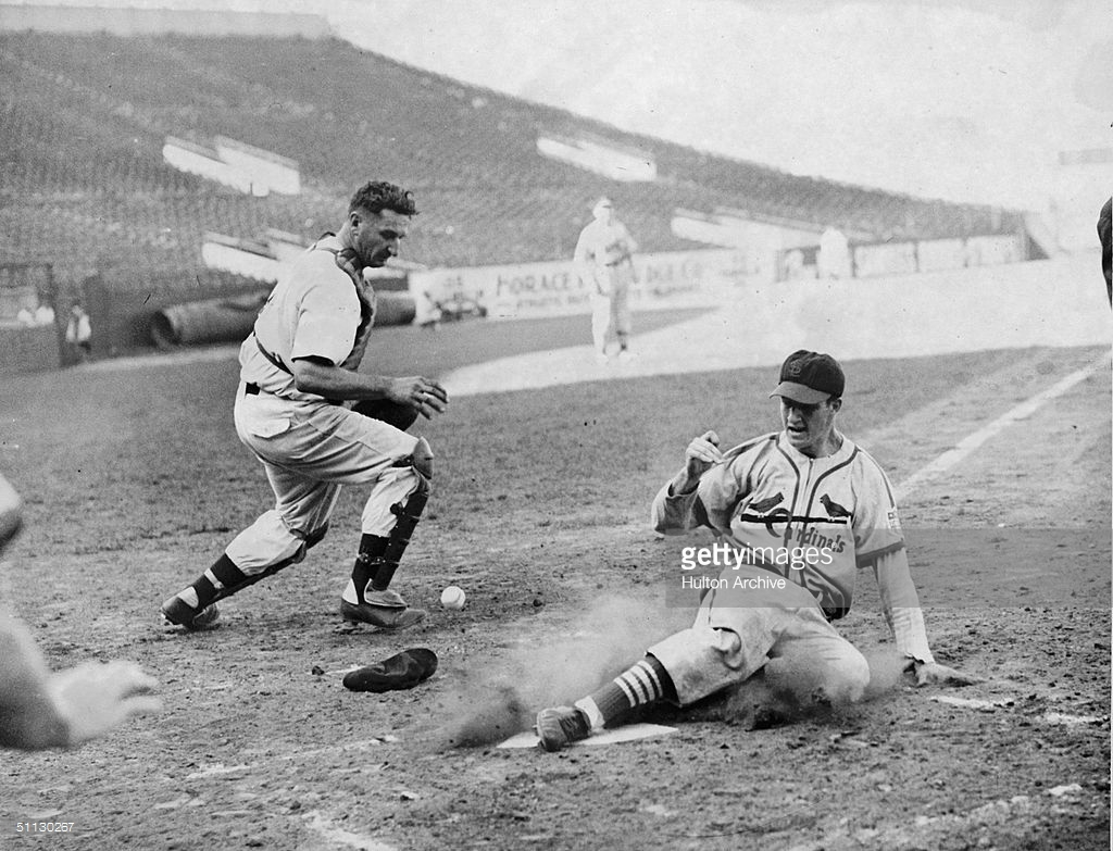 Stan Musial Slides Into Home Plate In Game : News Photo