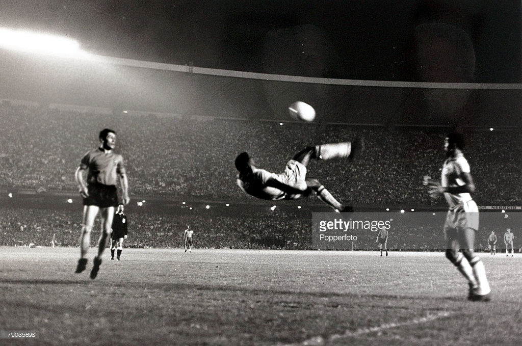 Sport. Football. Friendly International. Maracana Stadium, Rio de Janeiro. 2nd June 1965. Brazil 5 v Belgium 0. Brazil's Pele makes an attempt on goal with an athletic overhead kick. Pele was perhaps the most famous footballer of all time and featured in  : News Photo