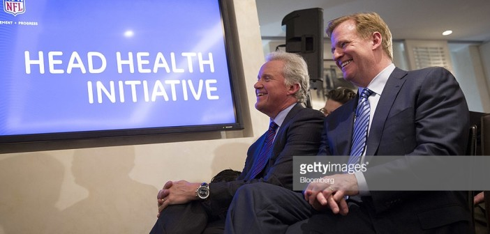 "Roger S. Goodell, commissioner of the National Football League (NFL), left, and Jeffrey ""Jeff"" Immelt, chairman and chief executive officer of General Electric Co. (GE), sit during a news conference in New York, U.S., on Monday, March 3, 2013. The National Football League, General Electric Co. and Under Armour Inc. will join in a four-year, $60 million effort to develop imaging technology for detecting, treating and preventing brain injuries. Photographer: Scott Eells/Bloomberg via Getty Images"